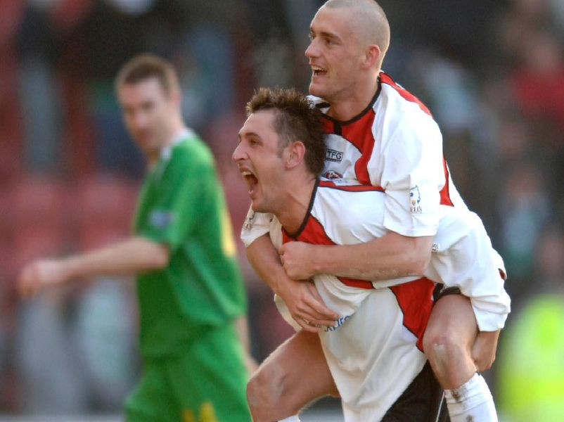 CLYDE V CELTIC, BROADWOOD STADIUM, CUMBERNAULD. CLYDE PLAYERS ALEX WILLIAMS AND THOMAS BRIGHTON CELEBRATE AFTER THEIR SHOCK 2-1 WIN OVER CELTIC.