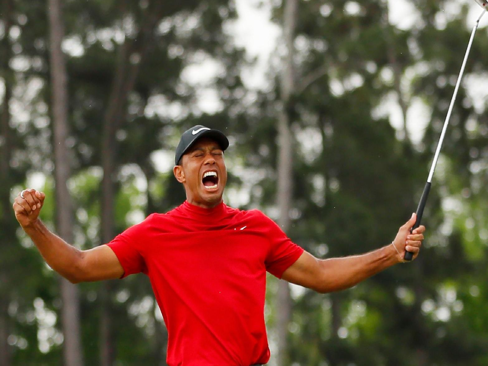 Tiger Woods celebrates after holing the putt that clinched the US Masters.