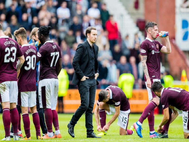Ian Cathro with his team ahead of a penalty shoot-out against Dunfermline in the Betfred Cup