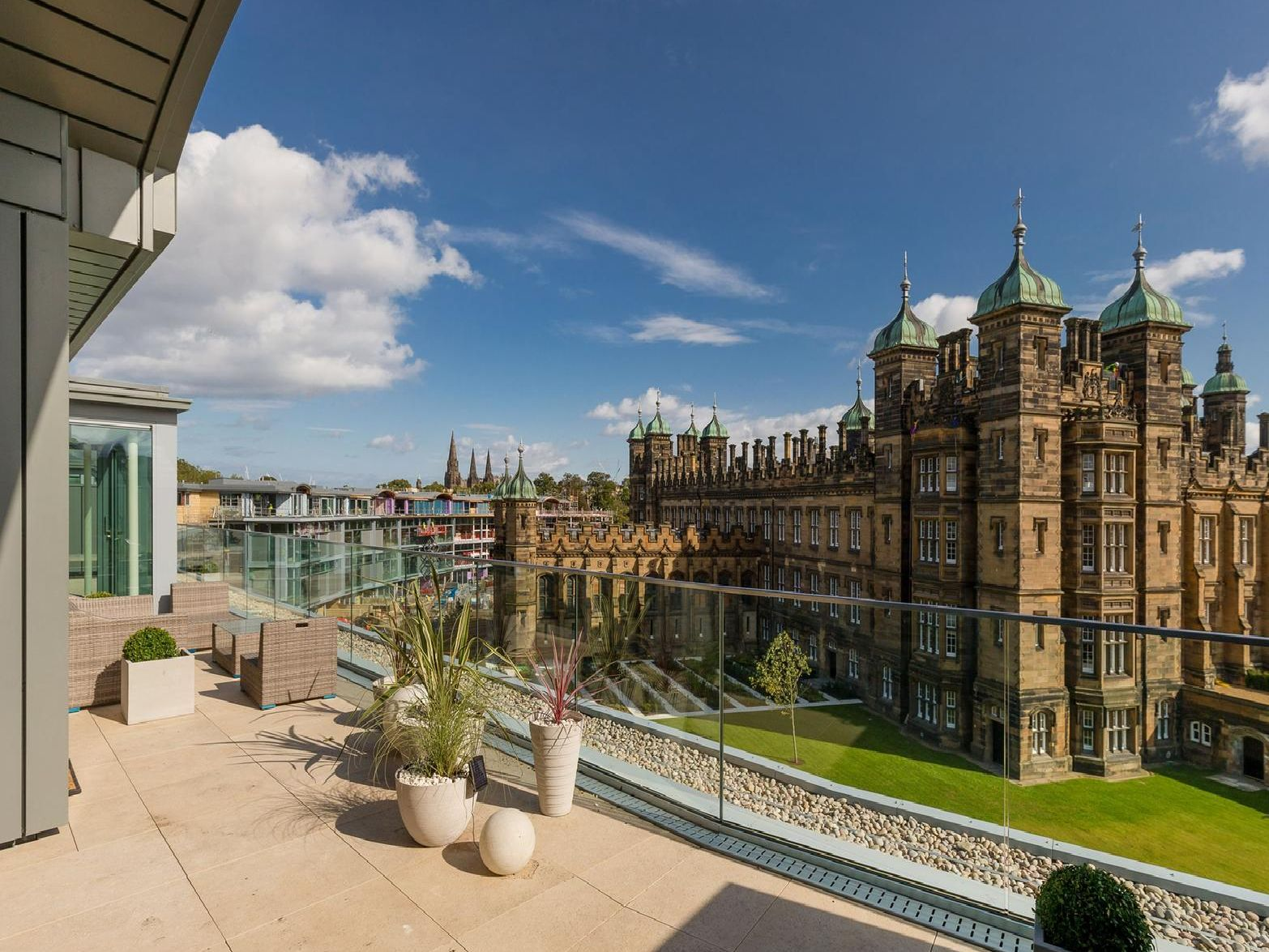 The flat has a breathtaking view of the school from its balcony