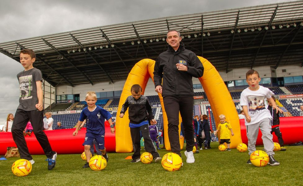Children's Football Festival. Falkirk Stadium 16/06/19 Children complete 6 activities and can send off for a free leather football. Davie Weir came along to help with the activities