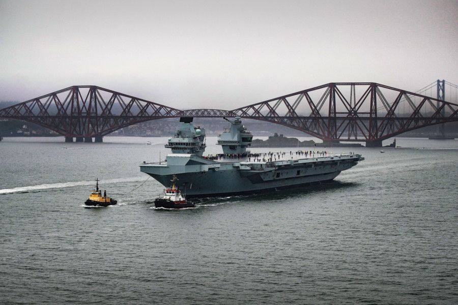 Britain's newest aircraft carrier, Prince of Wales, has sailed from Rosyth Dockyard for the very first time and passed under the Forth bridges to begin sea trials.