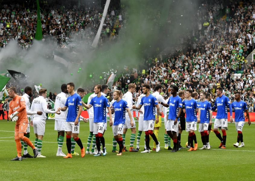 Celtic and Rangers players shake hands ahead of kick off. Picture: SNS