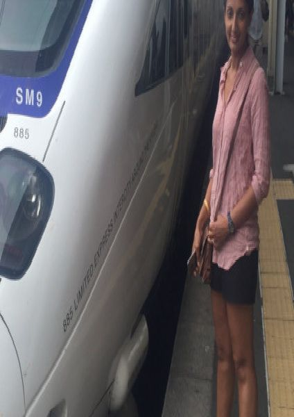 Monisha Rajesh about to board the Shinkansen to Kyoto, Japan, as part of her journey Around The World In 80 Trains