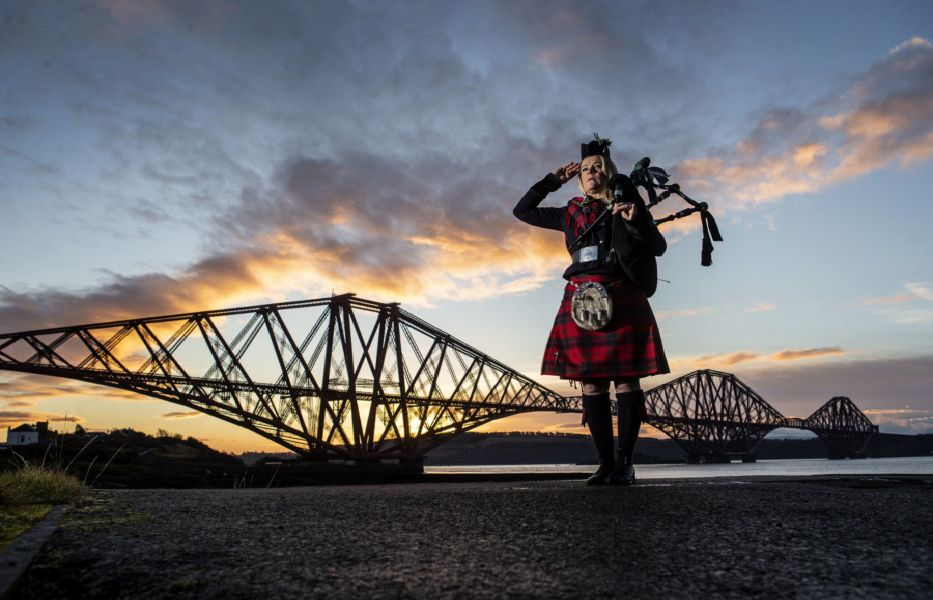 Piper Louise Marshall, wearing a special commemorative red tartan, plays Battle's O'er, the traditional Scottish lament played at the end of battle, at dawn alongside the Forth Bridge at North Queensferry on the 100th anniversary of the signing of the Armistice which marked the end of the First World War. PRESS ASSOCIATION Photo. Picture date: Sunday November 11, 2018. See PA story MEMORIAL Armistice. Photo credit should read: Jane Barlow/PA Wire