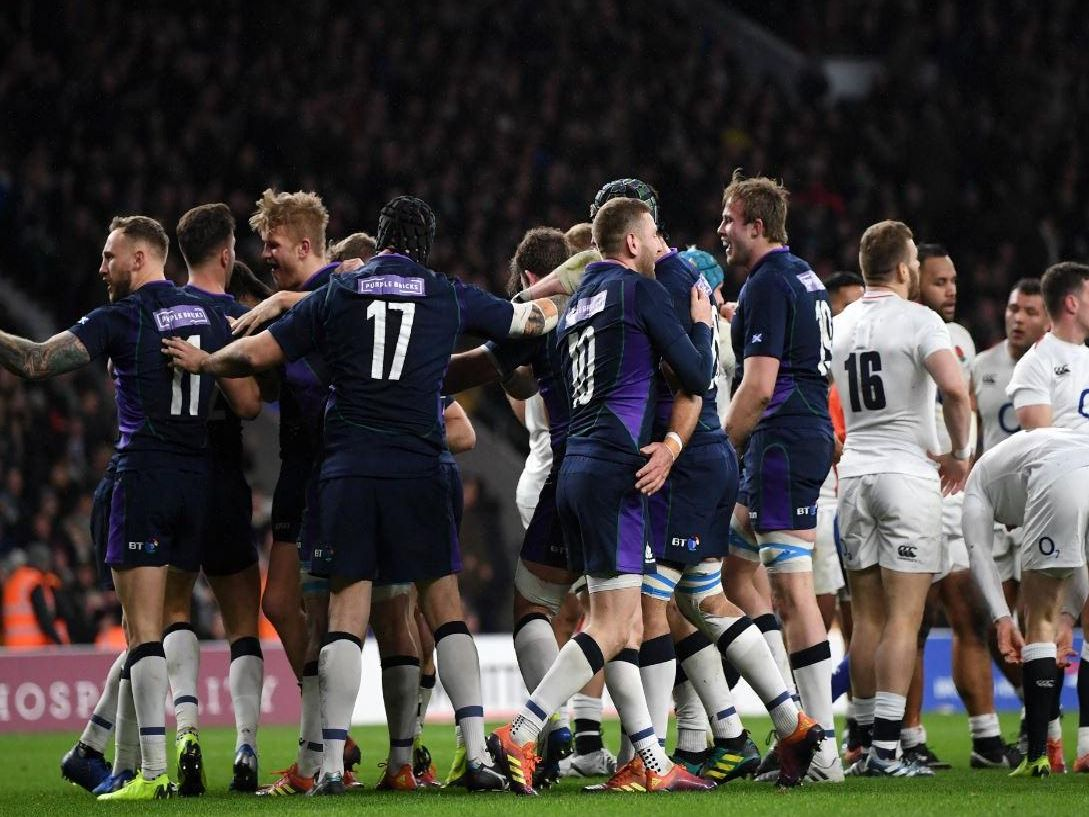 Scotland celebrate after scoring a try in the second half