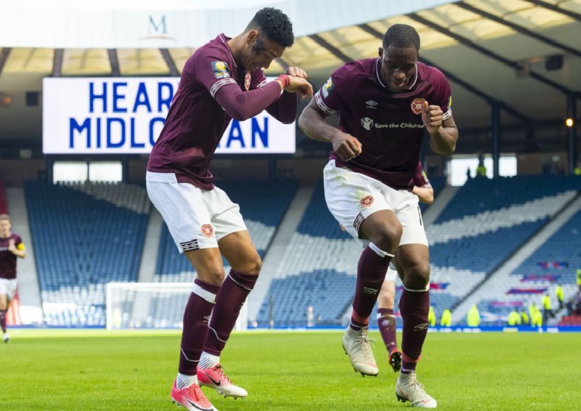 Hearts' Sean Clare dances with Uche Ikpeazu after the third goal. Pic: SNS/Craig Foy