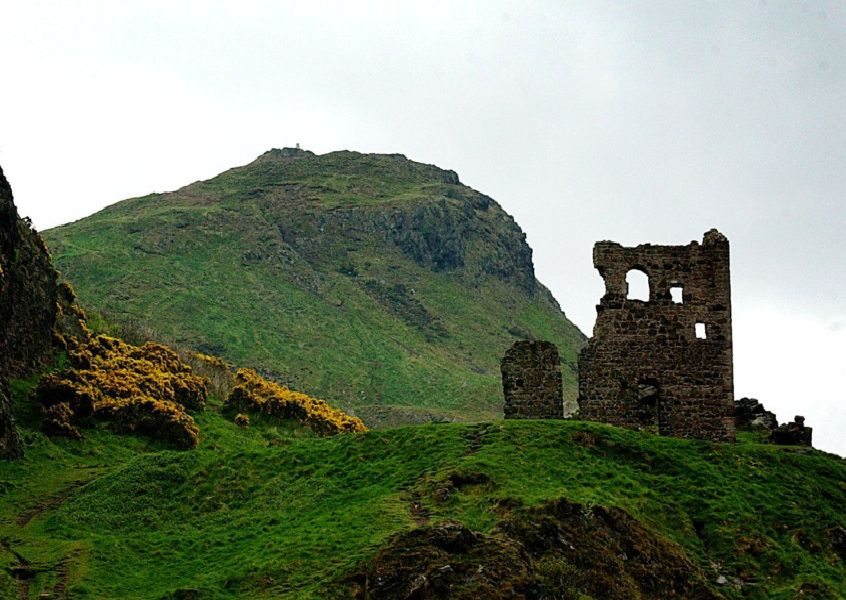 ARTHUR'S SEAT IN HOLYROOD PARK IN EDINBURGH WITH RUIN OF ST ANTHONY'S CHAPEL AT RIGHT.