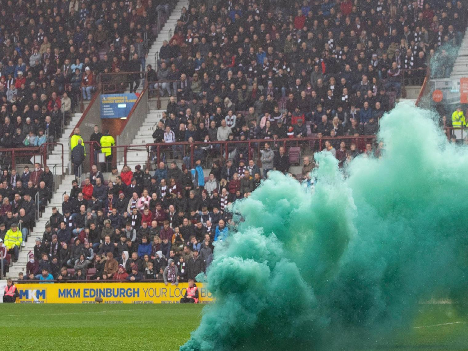 A flare is thrown onto the pitch at Tynecastle Park stadium