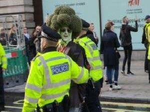 Man dressed as giant broccoli arrested by police at Extinction Rebellion protests