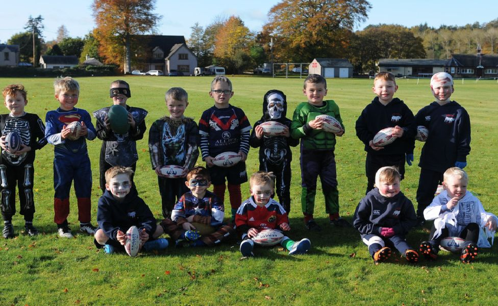 Players in fancy dress at a Halloween-themed Selkirk Rhinos training session.