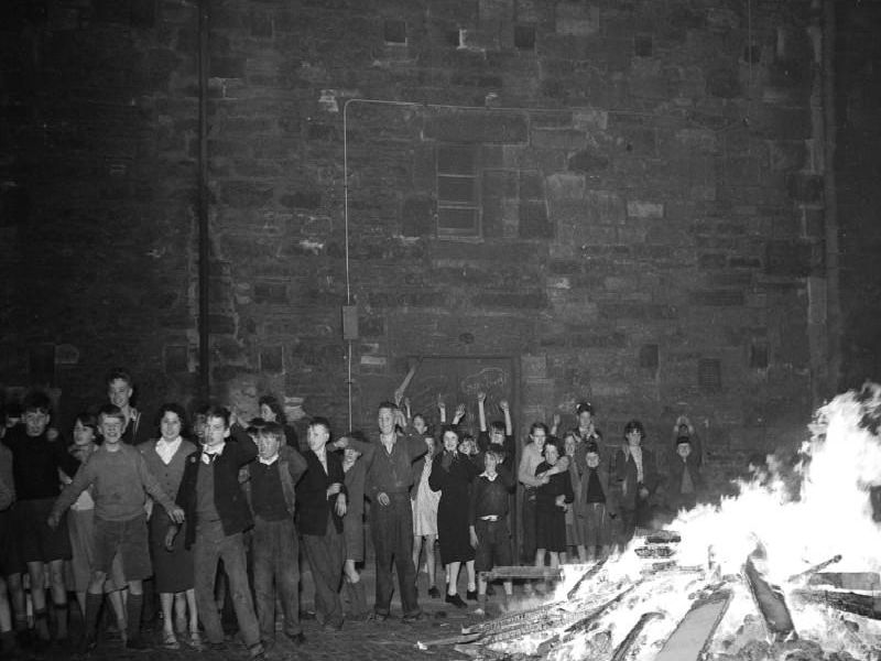 Bonfire watched by children in Dumbiedykes - Holyrood area on 5th November, 1956.