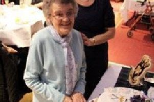 Lauder SWI centenary birthday cake was cut by Mary White