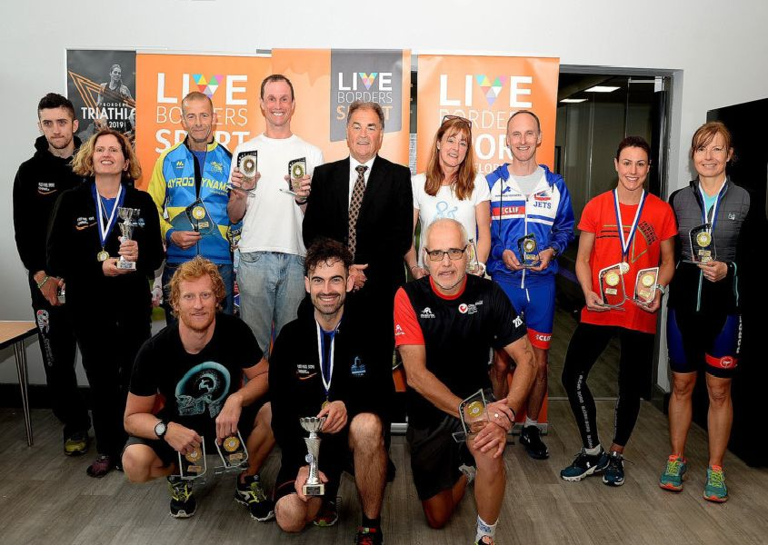 Live Borders chairman Bill White presents the winners from the Selkirk Standard Triathlon.