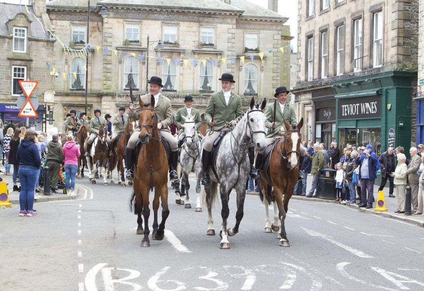 The principals lead the cavalcade through the town.