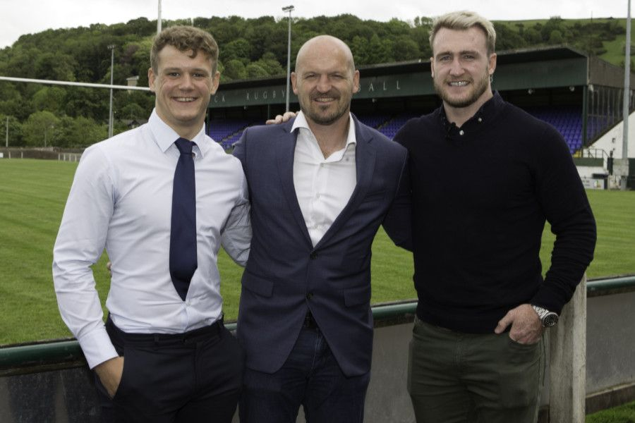 Darcy Graham, left, Gregor Townsend and Stuart Hogg in the shadow of the HAwick RFC stand.