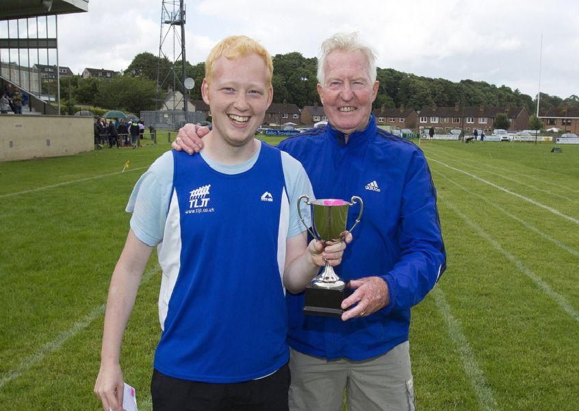 Dylan Murray won the 200m Open, pictured with his coach John Steede