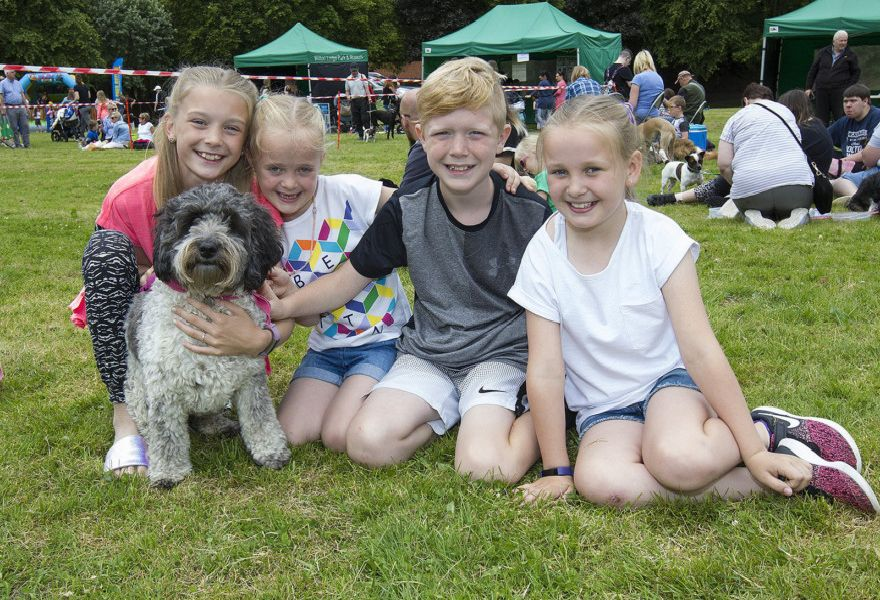 Marley and Rylee Domingo, with Braedyn and Hudson McLeod and Pixie the dog at Bark in the Park.