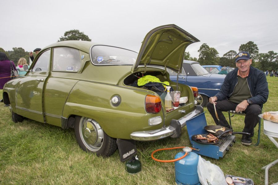 Martin Wichstead from Currie prepares beakfast next to his Saab.