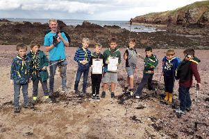 Local cubs did their bit to make the beach at Killiedraughts cleaner.