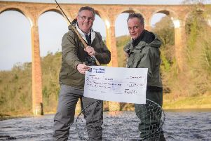 Mark Cockburn, CEO FishPal, presents Luke Comins, director, Tweed Forum, with a �1,986 donation from anglers who fish on the River Tweed and its tributaries.