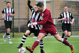 Eyemouth (in maroon) in action against Dunipace (Pic: Alan Murray)