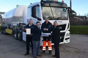 Tarmac's George Gowans, Scott Lindsay and Kenny Smith are delighted to receive the national FTA award from Eric Highman.