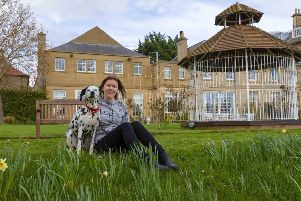 BHA'S pet champion Nikki Robertson with her own dog Maddie who made the news some time ago after falling of Berwick Walls.
