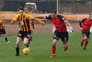 Action from Saturday's defeat to Elgin as Lewis Barr takes on City centre half Darryl McHardy. (Pic: Alan Bell)