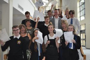 Pupils receive exam results as figures show continued success