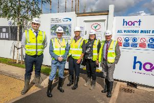 Kevin Stewart MSP (second, left) at the  Duns development with (l-r) Hart Builders site manager Kyle Tod, Trust Housing CEO Rhona McLeod, Hart Builders business development director Gill Henry and Councillor Mark Rowley.''Pic: Andy Barr''www.andybarr.com''� Andrew Barr Photography.
