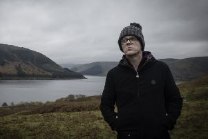 Darren McGarvey and the landscape from Scott's View. (Photo: BBC Scotland/Tern TV)