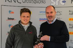 Max Redpath, left, receives the Star Driver Award from 2001 WRC champion Robert Reid (picture by Eddie Kelly).