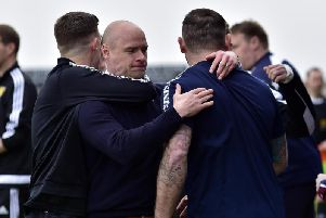 Brown Ferguson celebrates with his backroom team. Picture Duncan Brown