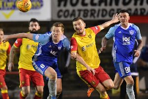 Scott Brown battles for possession with Shaun Rodgers during Peterhead's win at Albion Rovers (pic by Duncan Brown)