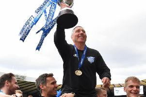 Jim McInally lifts the Scottish League 2 trophy