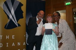 Isabelle accepts her award from Mike Stevenson of Thinktastic and The Diana Award CEO Tessy Ojo