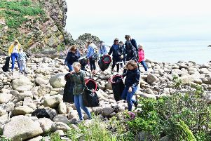 BEACH CLEAN AT NORTH HAVEN, NEAR THE BULLLERS OF BUCHAN ''VOLUNTEERS CLAMBER OVER ROCKS TO COLLECT RUBBISH