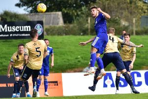 Jack Leitch heads in Peterhead's winner against Forfar Athletic (pic: Duncan Brown)