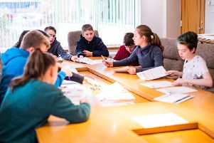 Pupils from the winning school Kemnay Academy, taking part in the Boardroom'challenge in the Boardroom at Stewart Milne Groups Aberdeen office,