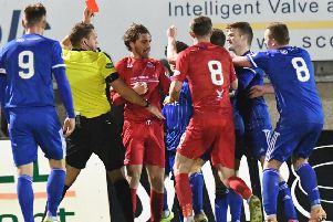 Referee Chris Graham shows red to Peterhead's Simon Ferry as tempers fray (pic: Duncan Brown)