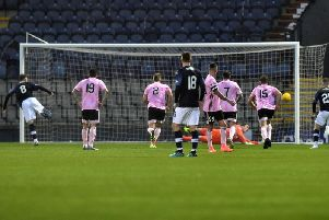 Peterhead goalkeeper Greg Fleming makes a penalty save to deny Regan Hendry. Pic: Duncan Brown