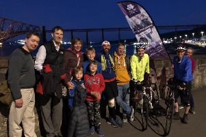 Hero's welcome...family and friends met Mark Calder at the Forth Bridges to celebrate his achievement, on the final leg of his mammoth Running Home 2019 challenge.