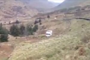 A Facebook screen-grab from Jason Ferguson's video showing Chris Roberts' van after it was blown off the A83 at the Rest and Be Thankful during Storm Henry.