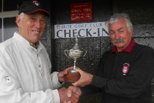 Bute Golf Club seniors champion Sandy Long (left) is presented with the seniors cup by past-captain Cammy 'Middleton