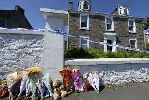 Tributes   outside the house where 6-year-old Alesha MacPhail had been staying on the Isle of Bute outside Rothesay. July 3 2018 Photo by James Chapelard, SWNS