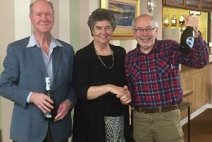 The Rotary Club of Rothesay  indoor bowling tournament at Craigmore Bowling Club. The tournament was won by Roger Connard and Ralph Anderson pictured here being presented with their prize by the president of the bowling club Frances Kelly.