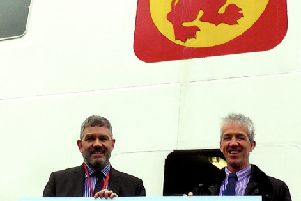 CalMac's Director of Community and Stakeholder Relations Brian Fulton (L) presents the donation to Society Chairman, Michael Abram.