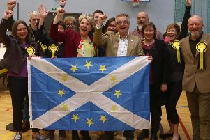 Brendan O'Hara MP (centre) among the SNP members celebrating the party's European election victory.