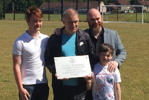 John Allan (centre) at opening of Crawforddyke Primary pitch named after him